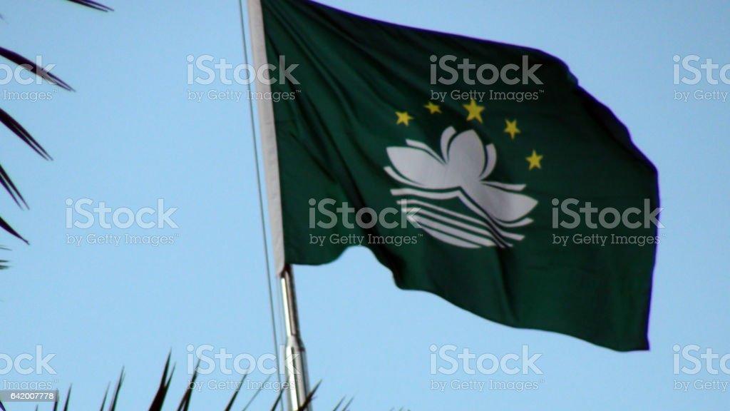 Flag Of Macau Waving Against Blue Sky In Macau.China stock photo