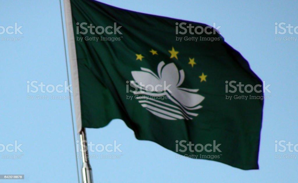 Flag Of Macau Waving Against Blue Sky In Macau.China.Asia stock photo