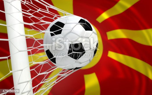 istock Flag of Macedonia and soccer ball in goal net 479486529