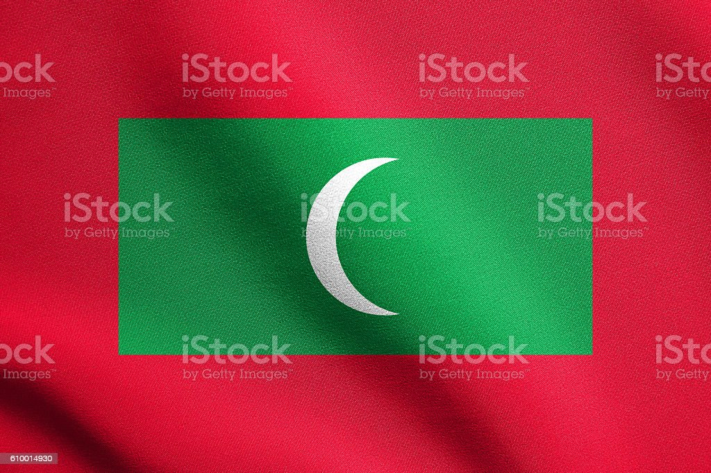 Flag of Maldives waving with fabric texture stock photo