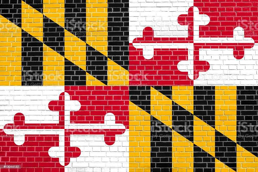 Flag of Maryland on brick wall texture background stock photo