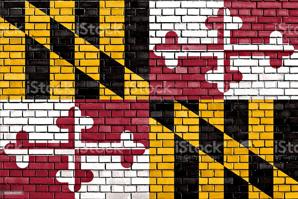 flag of Maryland painted on brick wall stock photo