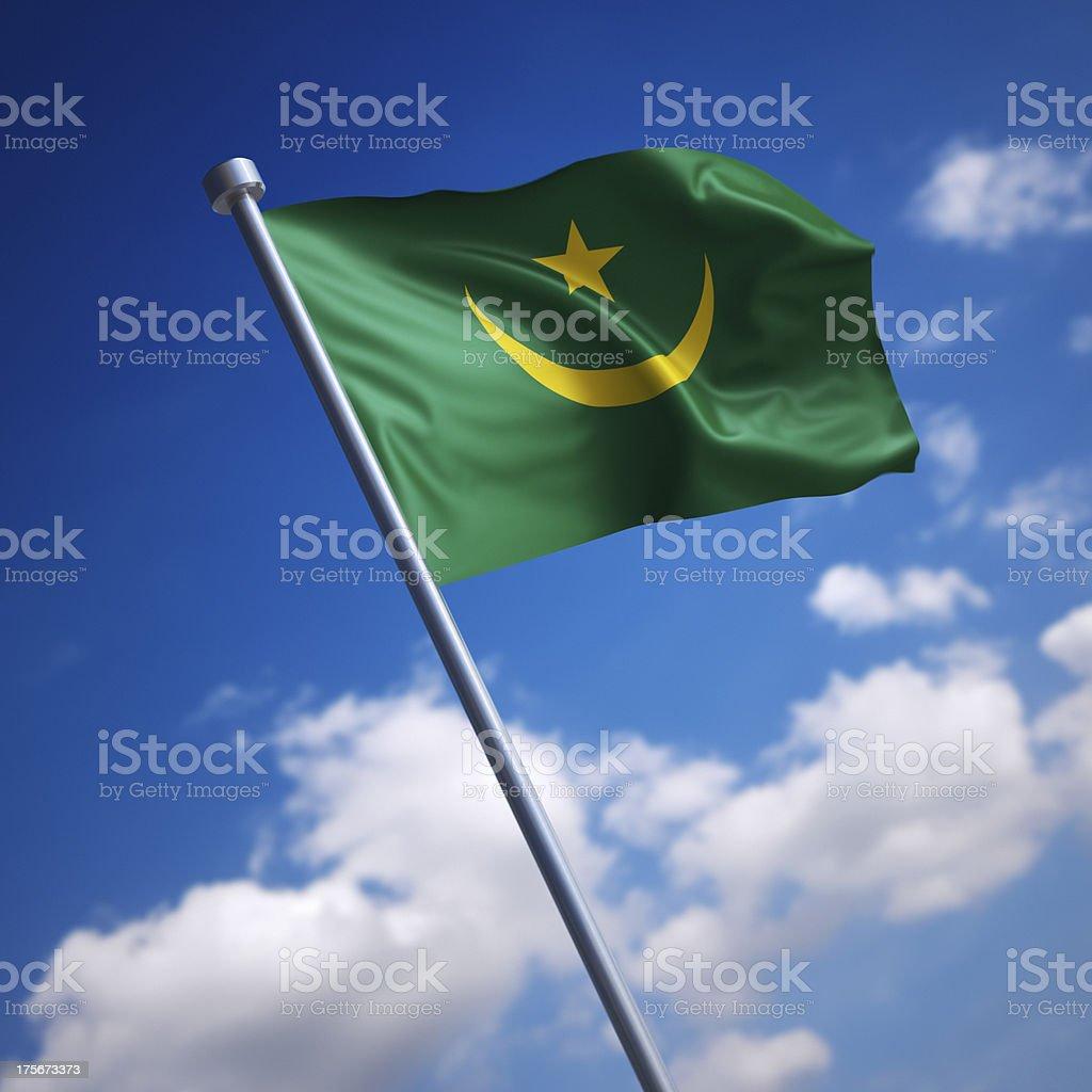 Flag of Mauritania against blue sky stock photo