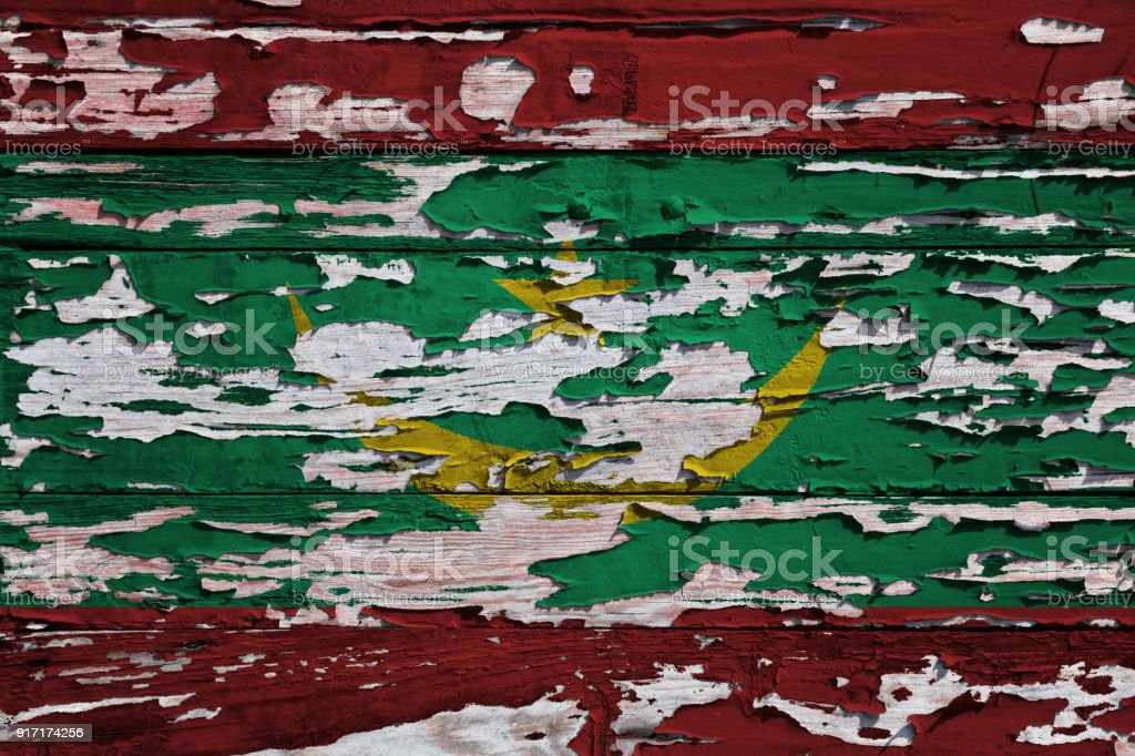 Flag of Mauritania painted on a grunge plank stock photo