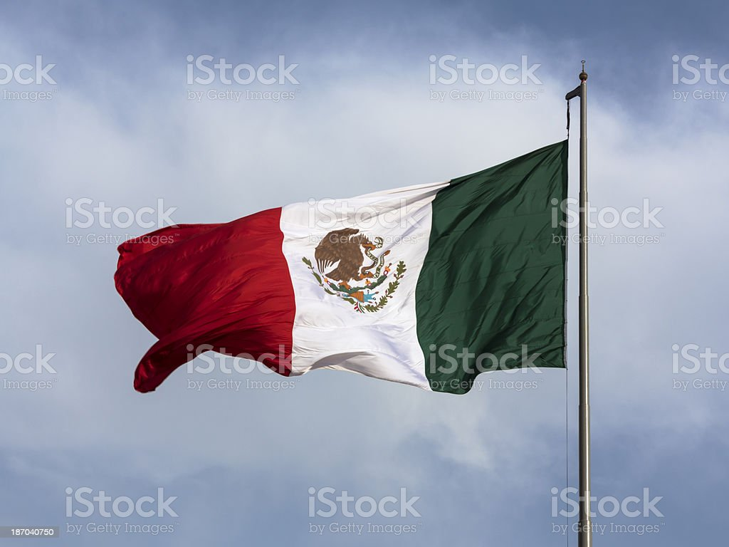 Flag of Mexico with blue sky royalty-free stock photo