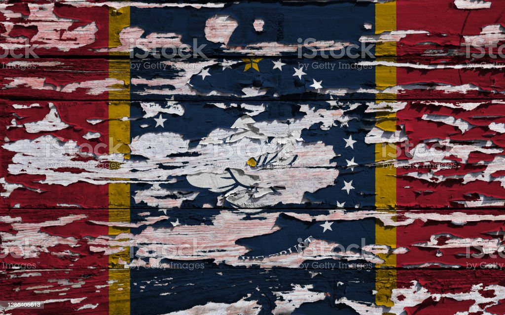 Flag of Mississippi painted on a grunge plank Flag of Mississippi (USA) painted on a grunge wooden board. American Culture Stock Photo