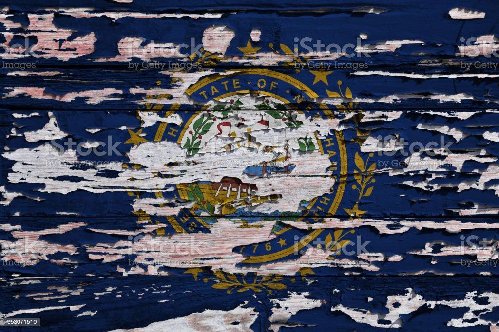 Bandeira de Nova Hampshire pintado numa prancha de grunge - foto de acervo