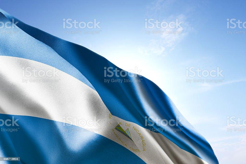 Flag of Nicaragua waving in the wind - foto de stock