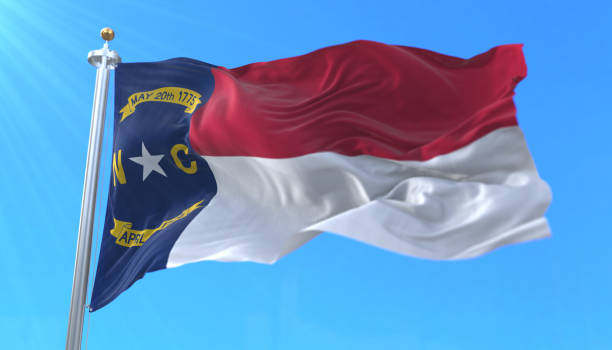 Flag of North Carolina state, region of the United States Flag of american state of North Carolina, region of the United States, waving at wind north carolina us state stock pictures, royalty-free photos & images