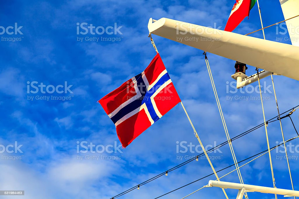 Flag of Norway on the mast of a cruise liner stock photo