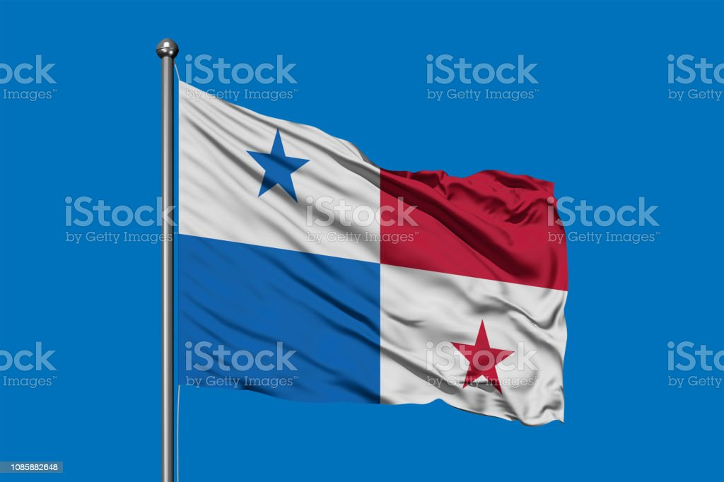 Bandeira do Panamá balançando ao vento contra o céu azul profundo. Bandeira do Panamá. - foto de acervo