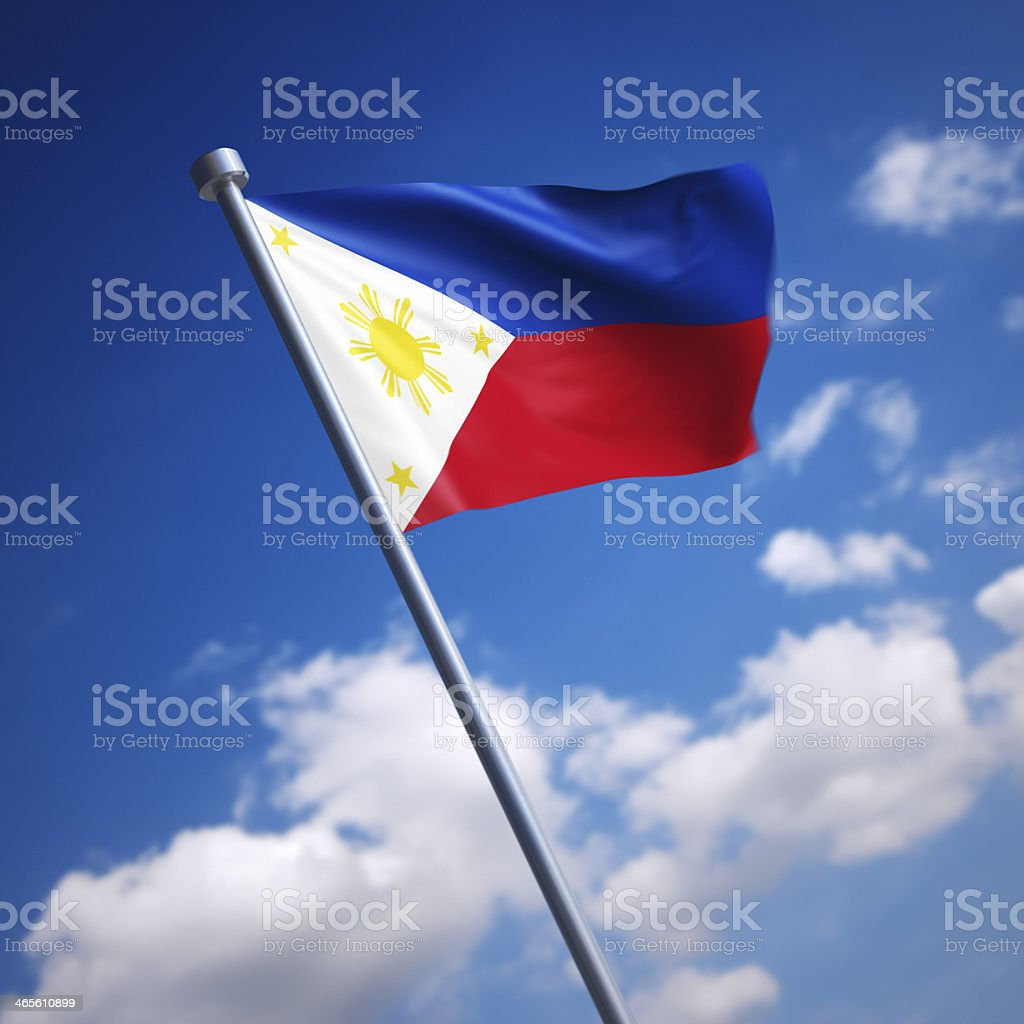 Flag of Philippines, the - against blue sky stock photo