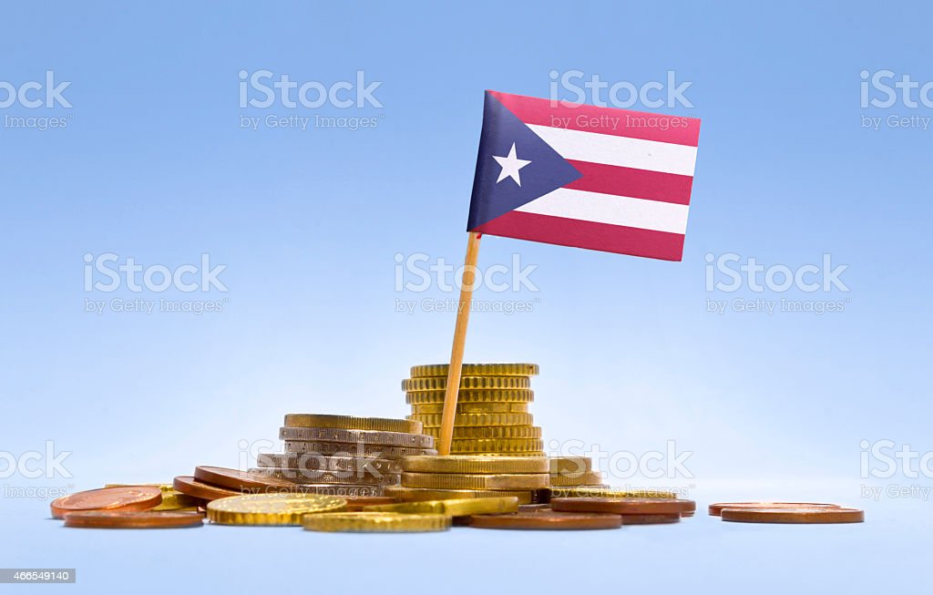Flag of Puerto Rico in a stack of coins.(series) stock photo