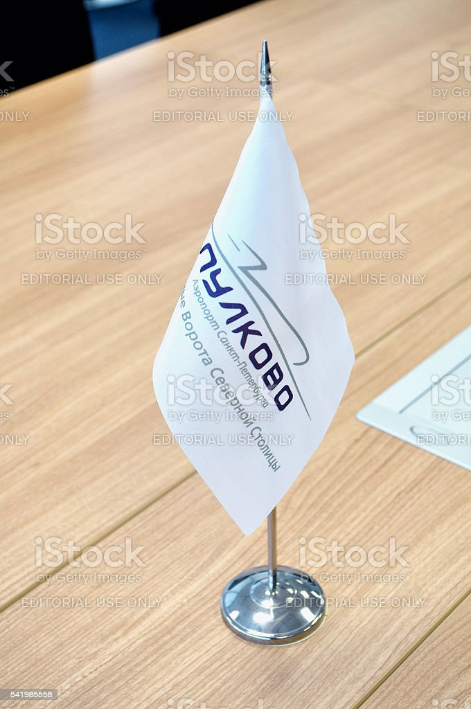Flag of Pulkovo airport on the stand on wooden table stock photo