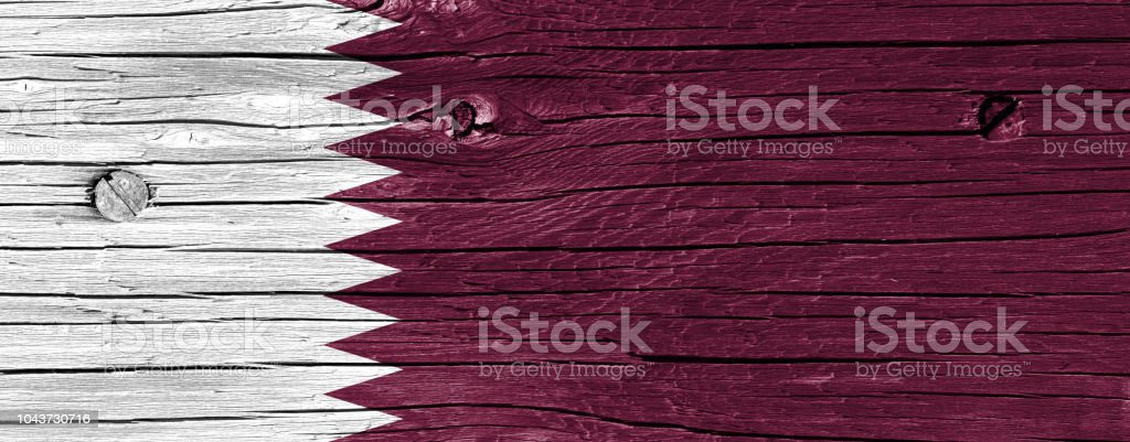 Bandera de Qatar en la madera - foto de stock