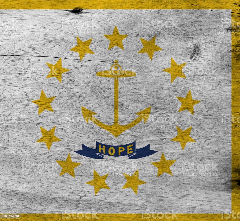 Flag of Rhode Island on wooden plate background. Grunge Rhode Island flag texture. stock photo