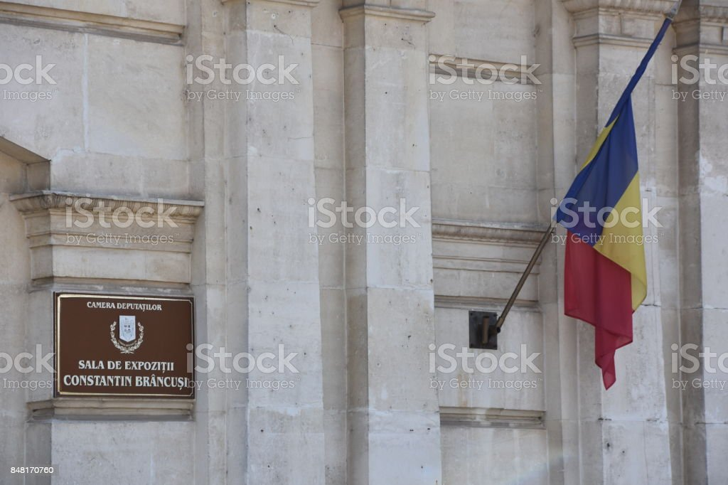 Flag of Romania on a public building stock photo