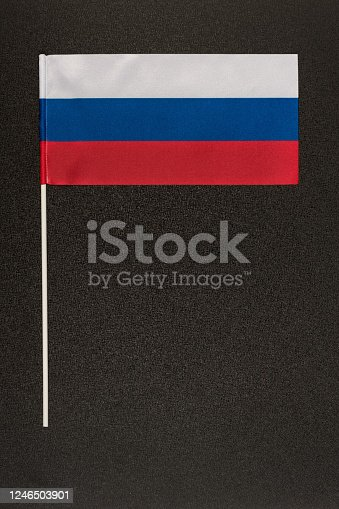 Flag of Russia on a black background. National symbol of Russia. Vertical frame.