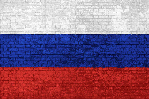 Wall of bricks painted with the of Russia Flag, white, blue and red in 3D background. Concept of social barriers of immigration, divisions, and political conflicts in Russia.