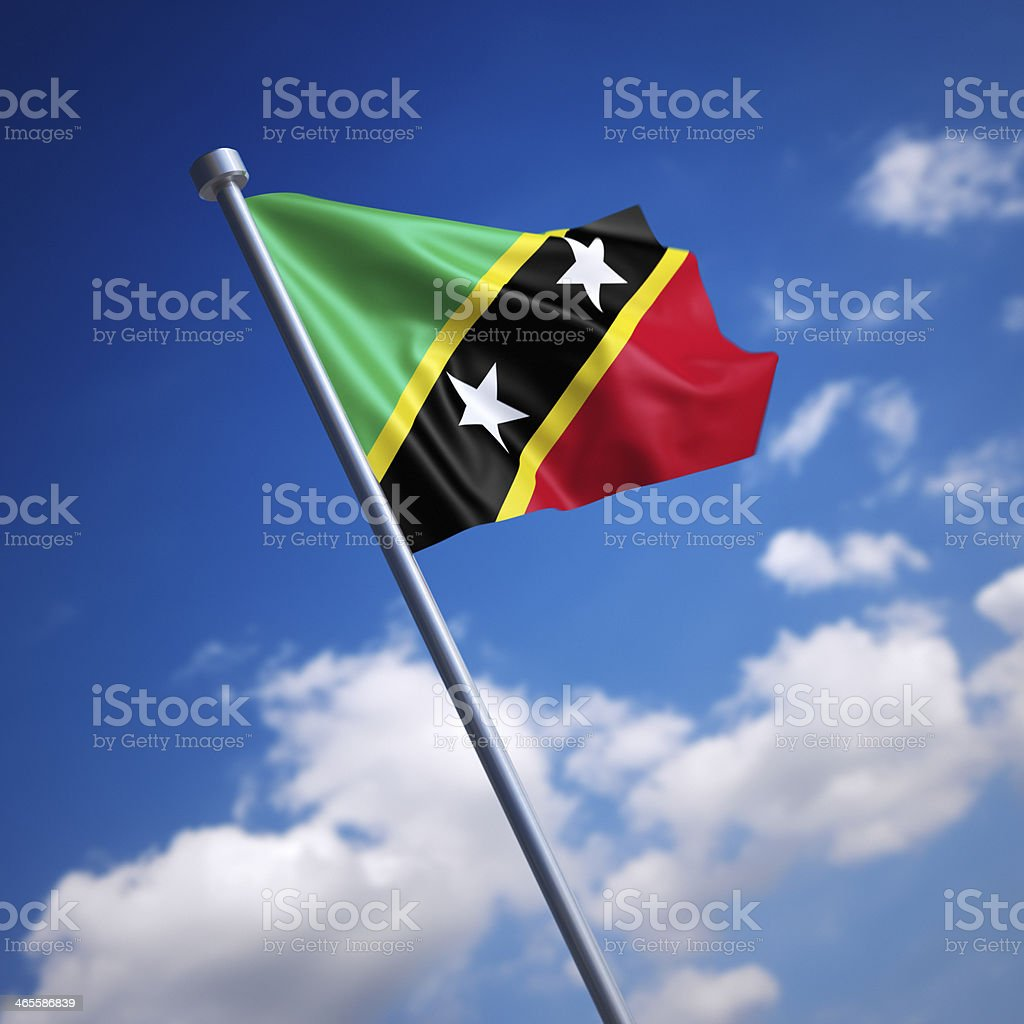 Flag of Saint Kitts and Nevis against blue sky stock photo
