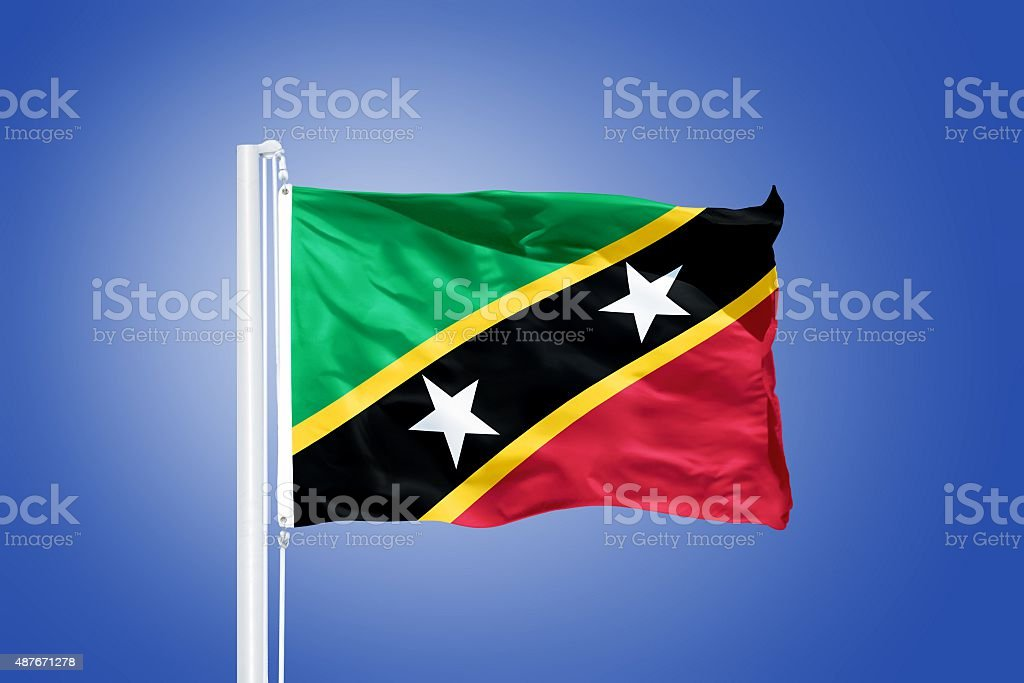 Flag of Saint Kitts and Nevis flying stock photo