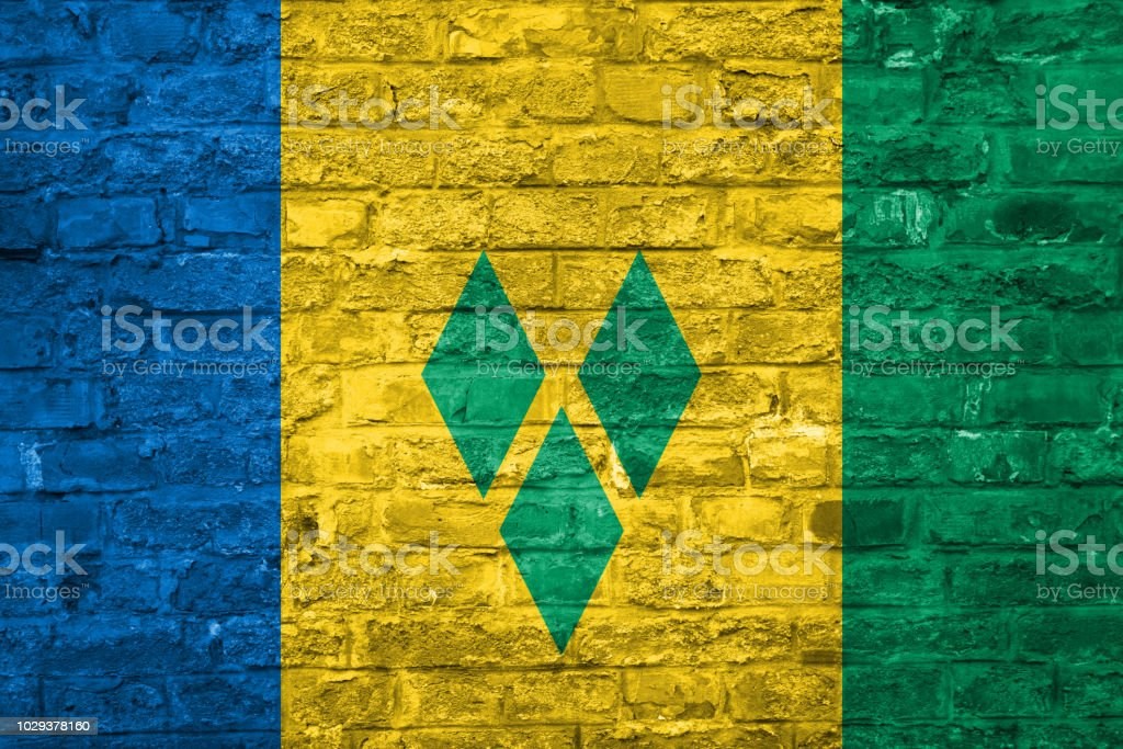 Bandeira de Saint Vincet e Granadinas sobre um antigo tijolo parede plano de fundo, superfície - foto de acervo