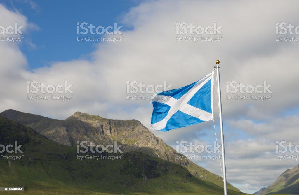 Flag of Scotland over Glencoe stock photo