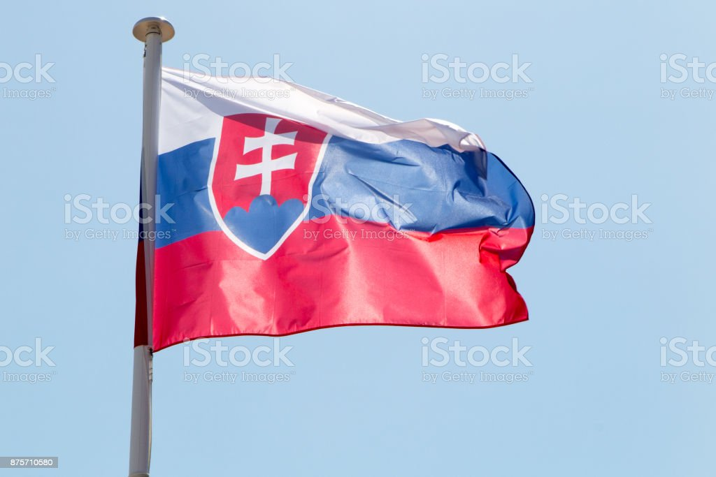 Flag of Slovakia waving in the wind under blue sky stock photo