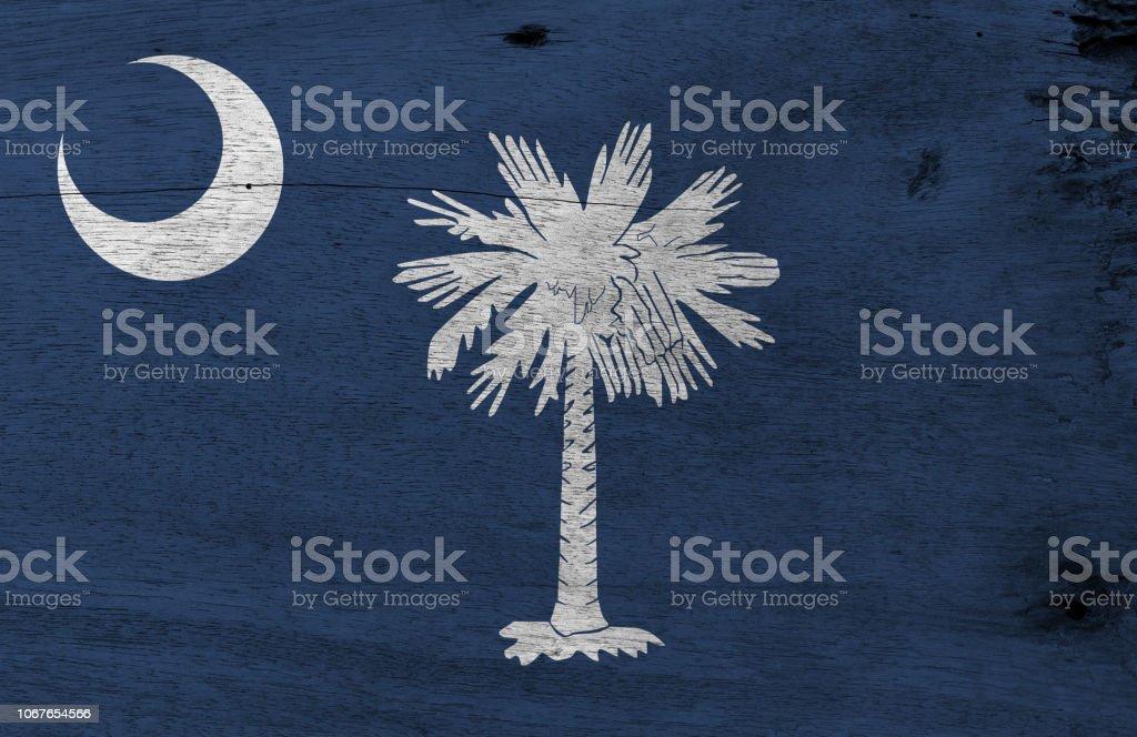 Flag of South Carolina on wooden plate background. Grunge South Carolina flag texture. stock photo