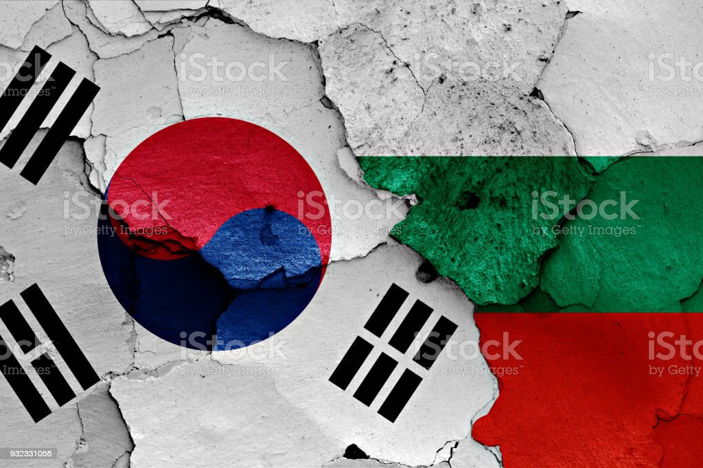 flag of South Korea and Bulgaria painted on cracked wall stock photo