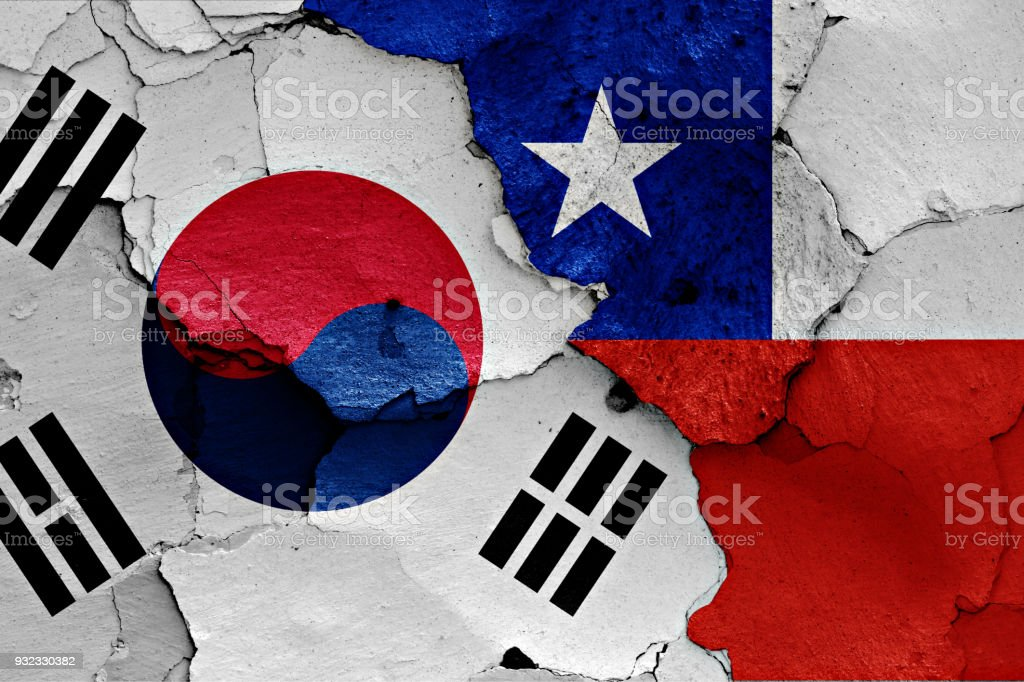 flag of South Korea and Chile painted on cracked wall stock photo