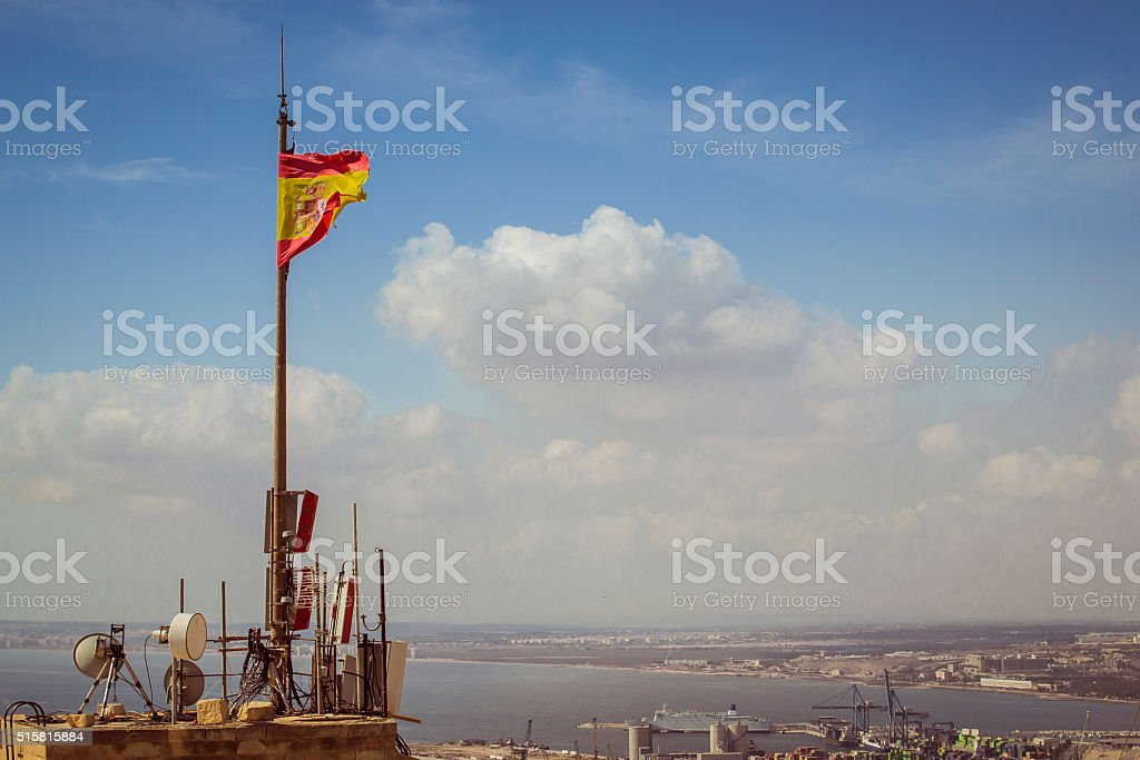 flag of Spain on tower of fortress of Santa Barbara stock photo