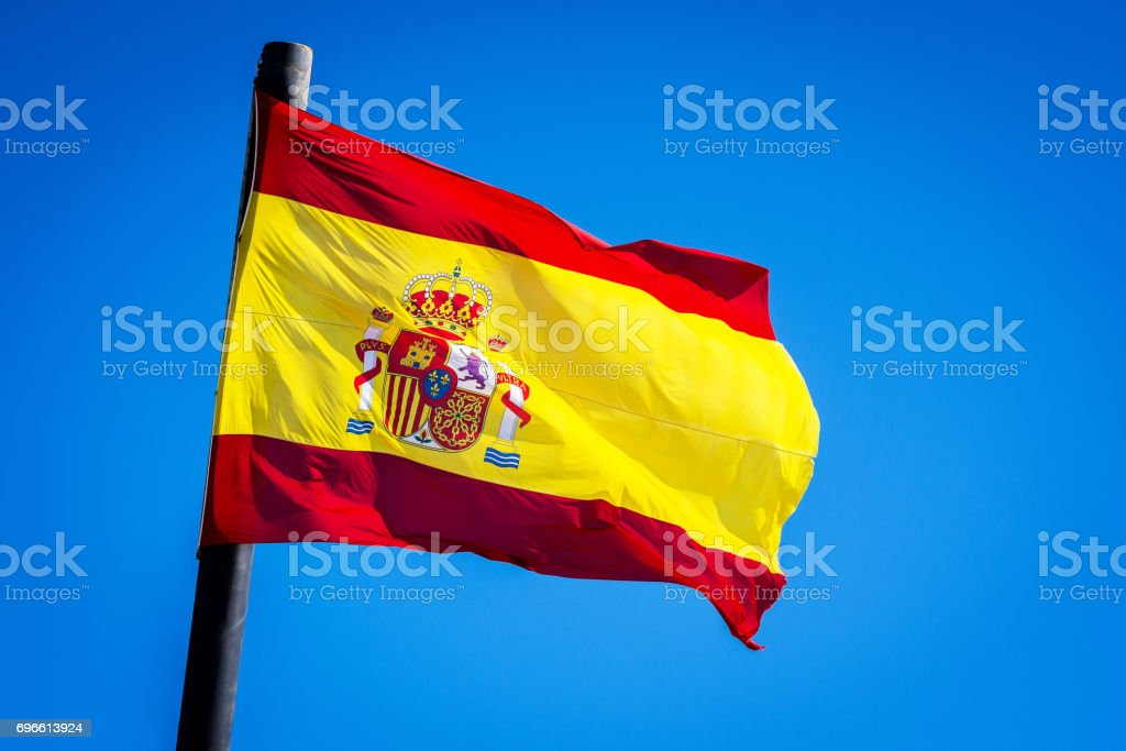 Flag of Spain Over a Blue Sky - foto stock