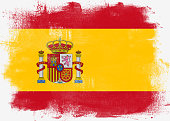 Flag of Spain painted with brush on solid background,