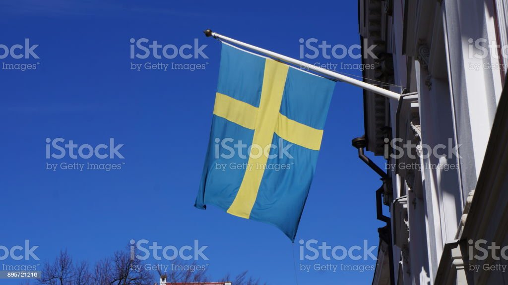 Flag of Sweden on a flagpole stock photo