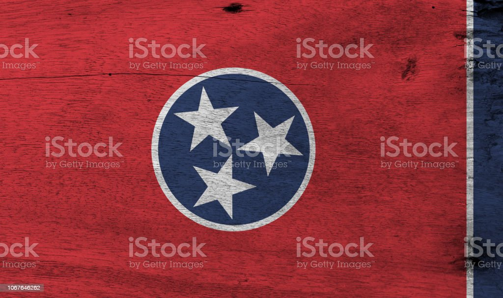 Flag of Tennessee on wooden plate background. Grunge Tennessee flag texture. stock photo