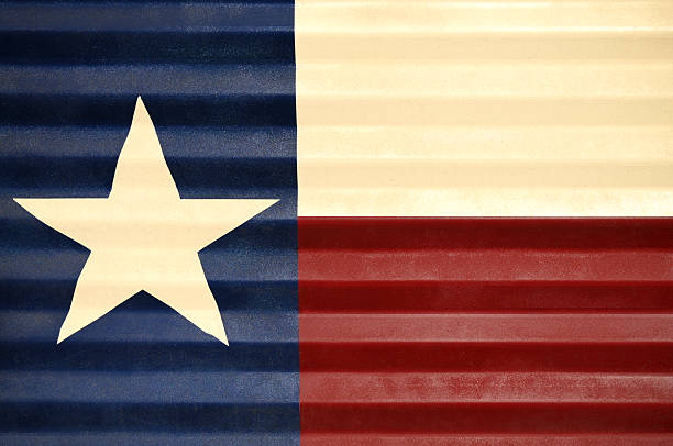 Flag of Texas on Fence stock photo