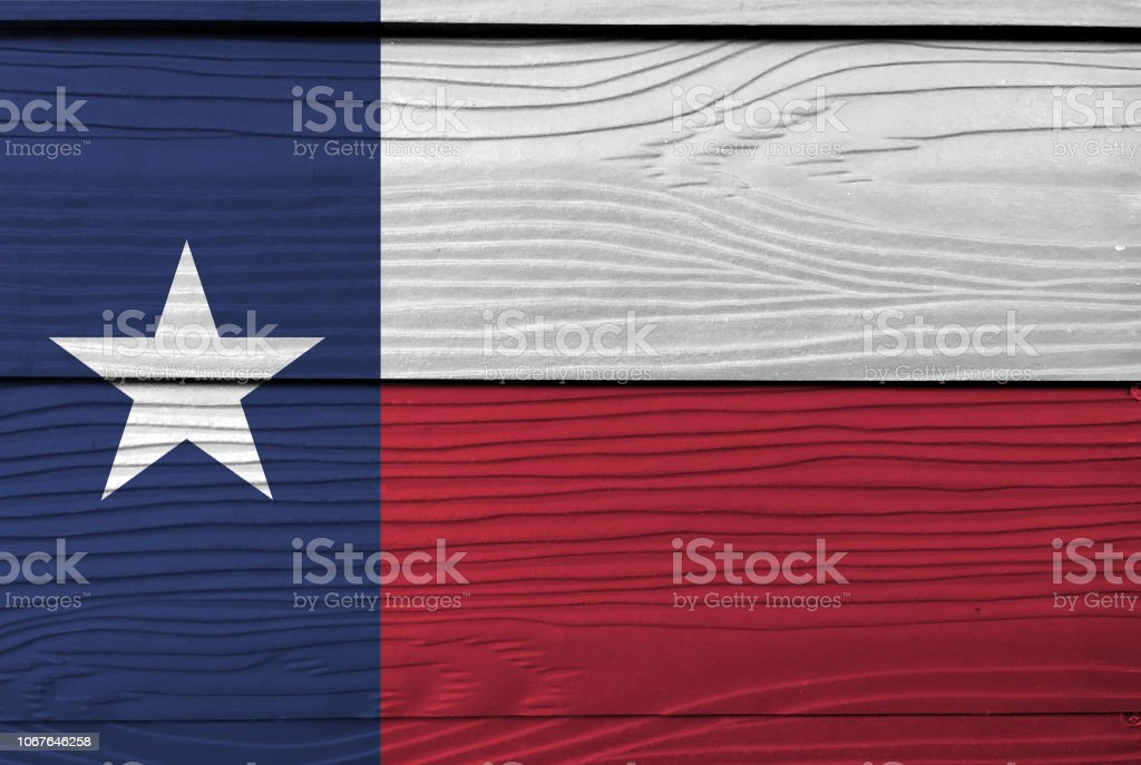 Flag of Texas on wooden plate background. Grunge Texas flag texture. stock photo