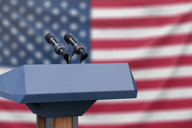 Flag of the United States at a press conference with microphones Podium lectern with two microphones and United States flag in background debate stock pictures, royalty-free photos & images