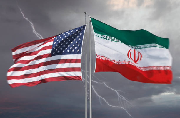 Flag of the United States of America and Iran Flag of the USA and Iran with strom behind illustrating difficult relationships of these countries iran stock pictures, royalty-free photos & images