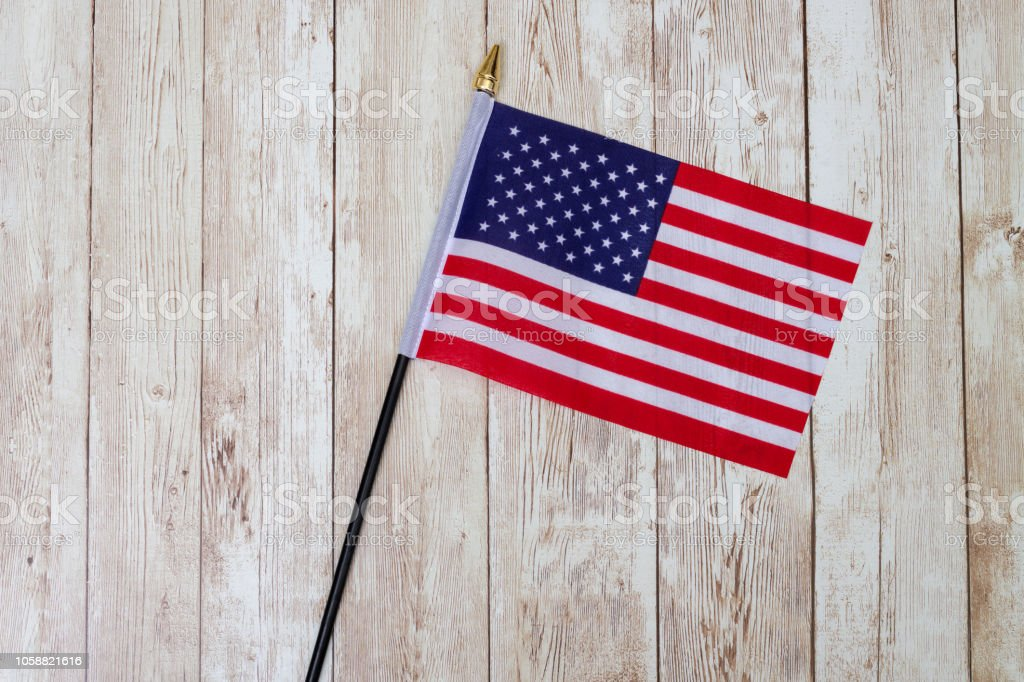 Flag of the USA on a wooden table top stock photo