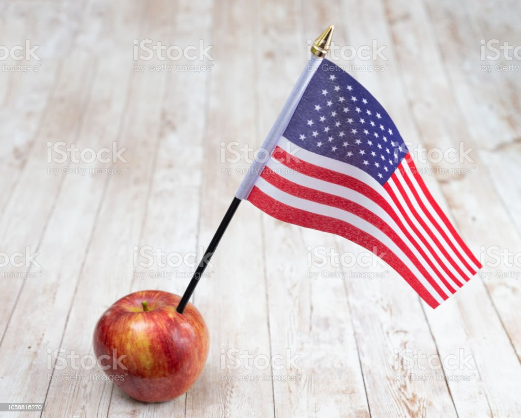 Flag of the USA stuck in an apple stock photo