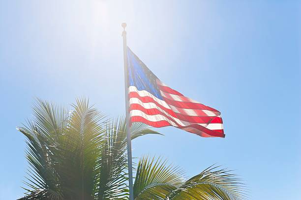Flag of the USA waving in bright sunlight stock photo