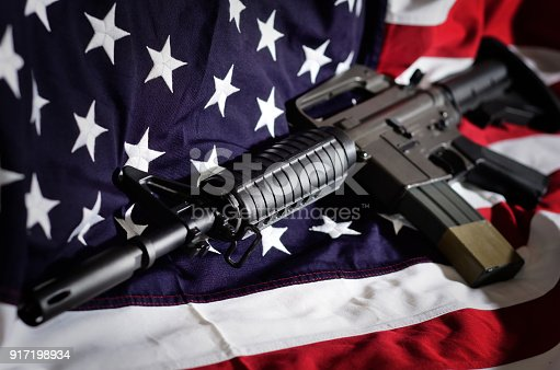 istock Flag of the USA with rifle 917198934