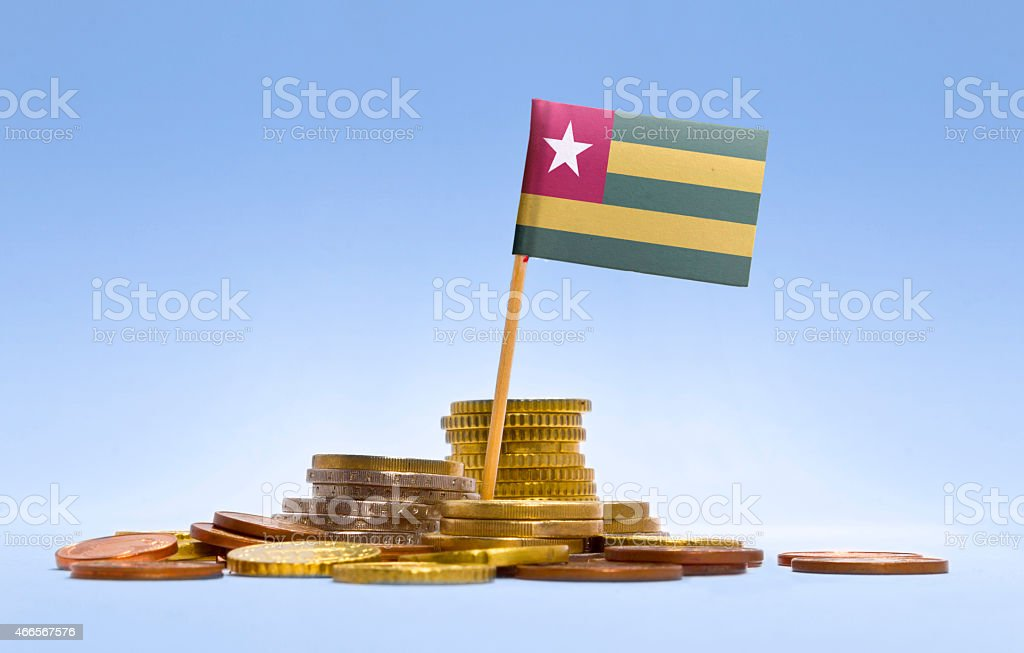 Flag of Togo in a stack of coins.(series) stock photo