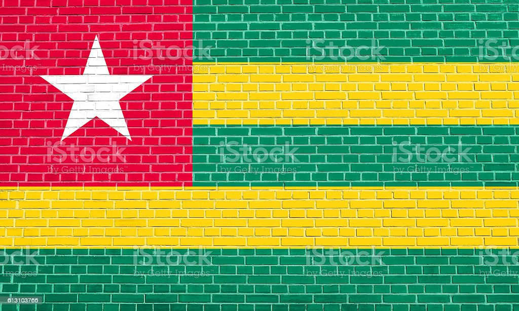 Flag of Togo on brick wall texture background stock photo