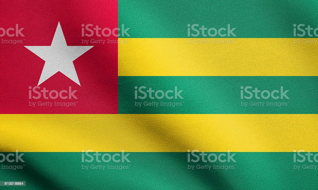 Flag of Togo waving with fabric texture stock photo