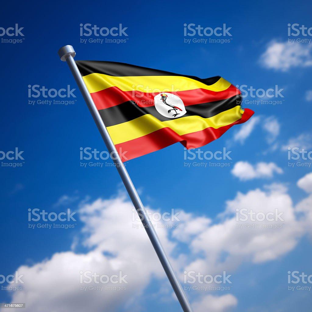 Flag of Uganda against blue sky stock photo