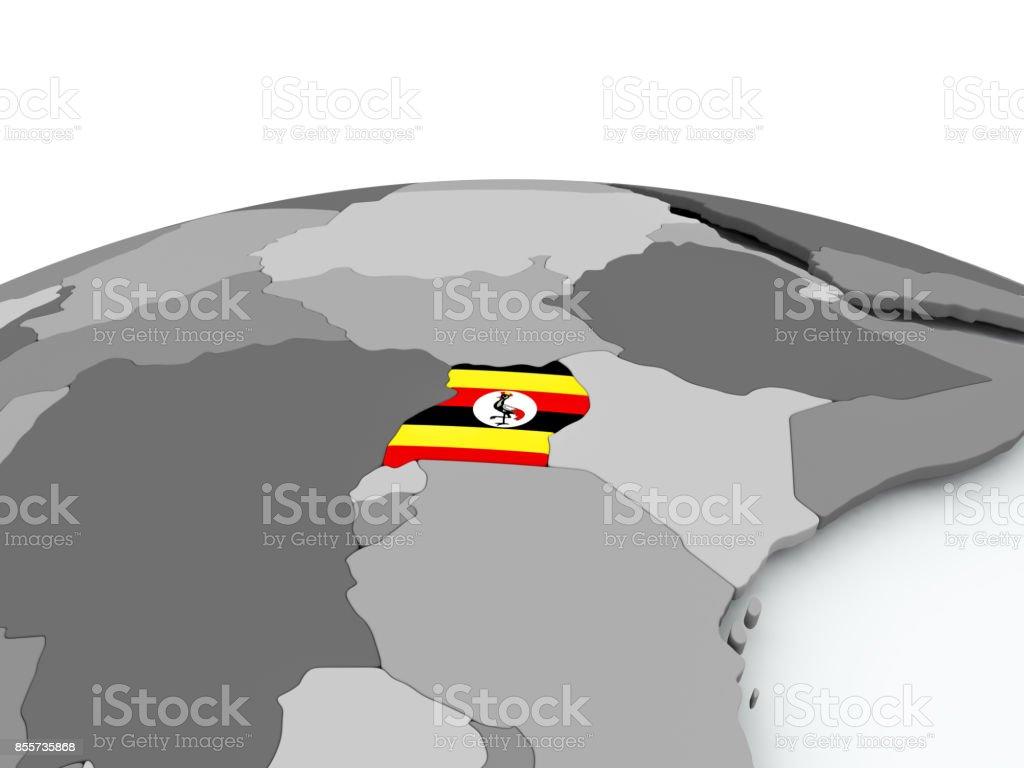 Flag of Uganda on globe stock photo