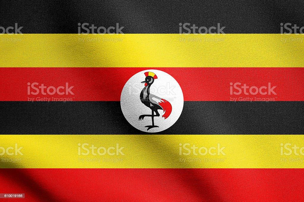 Flag of Uganda waving with fabric texture stock photo